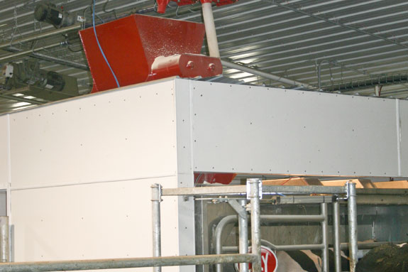 System designed to deliver high-moisture corn to cows when they come to be milked