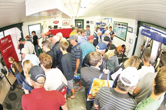 Visitors looking at DeLaval display