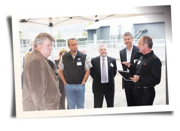 John De Jonge (right),  Bill Vanderkooi (left),  & members of local government.